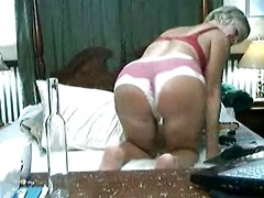 Granny does a webcam striptease and shows that big sexy ass and her old pussy