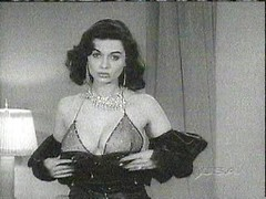 Sexy vintage burlesque girl strips from her dress and models amazing lingerie