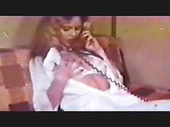 Vintage blonde gets excited on the phone and fills her pussy with a big toy