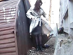 Classy girl in a dress and pantyhose takes a hot piss outdoors