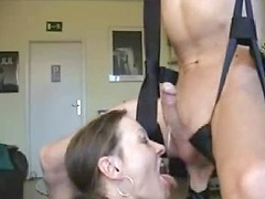 He sits in the sex swing as she gives an insanely sexy blowjob and plays with his ass