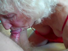Granny has red lingerie on as she gives her husband a sexy blowjob
