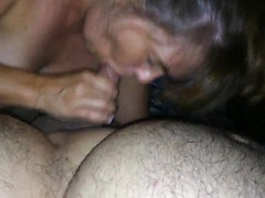 His mature wife is between his legs with her luscious lips wrapped around his hard dick